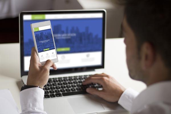 man looking at responsive website